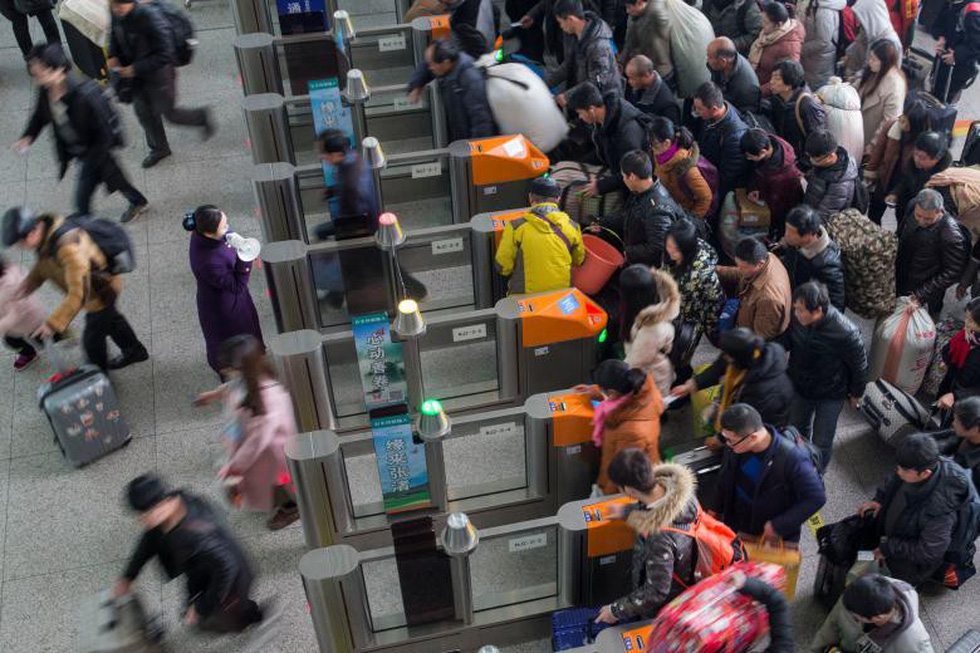 2,98 tỉ lượt dân Trung Quốc ùn ùn về quê ăn Tết - Ảnh 7.