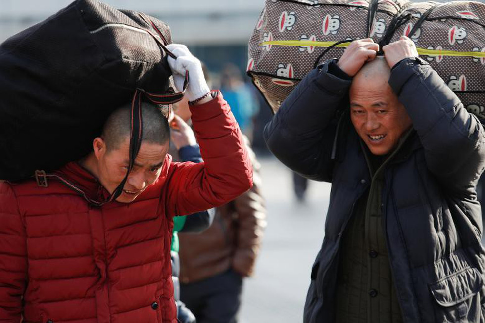 2,98 tỉ lượt dân Trung Quốc ùn ùn về quê ăn Tết - Ảnh 8.