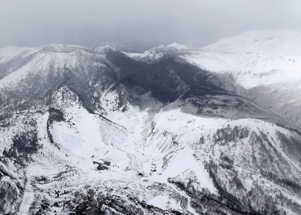 Bão tuyết, núi lửa cùng tấn công nước Nhật trong một ngày - Ảnh 9.