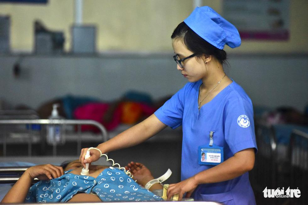 4 bé chào đời đúng thời khắc giao thừa ở TP.HCM - Ảnh 10.