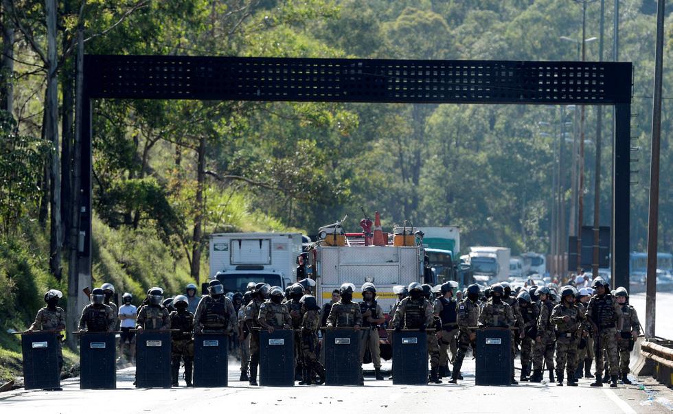 Vụ vỡ đập tại Brazil: Xác người bắt đầu nổi lên mặt bùn - Ảnh 4.