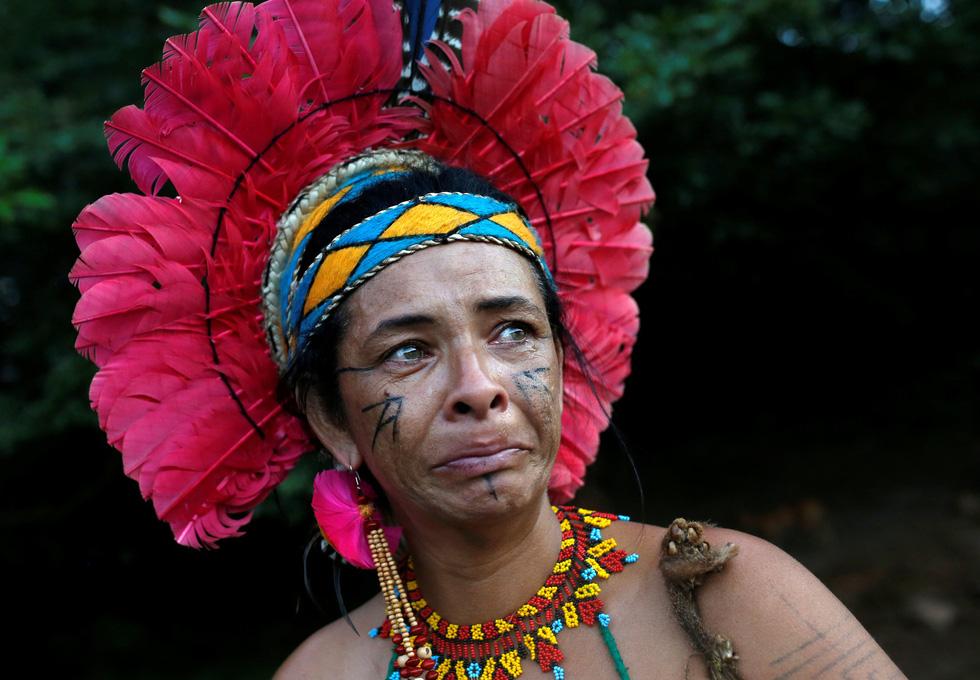 Vụ vỡ đập tại Brazil: Xác người bắt đầu nổi lên mặt bùn - Ảnh 1.