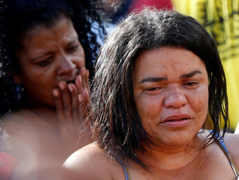 Vụ vỡ đập tại Brazil: Xác người bắt đầu nổi lên mặt bùn - Ảnh 6.