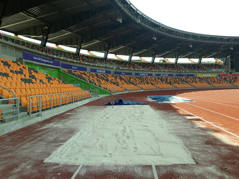 Sân thi đấu điền kinh đẹp long lanh sẵn sàng cho SEA Games 30 - Ảnh 9.