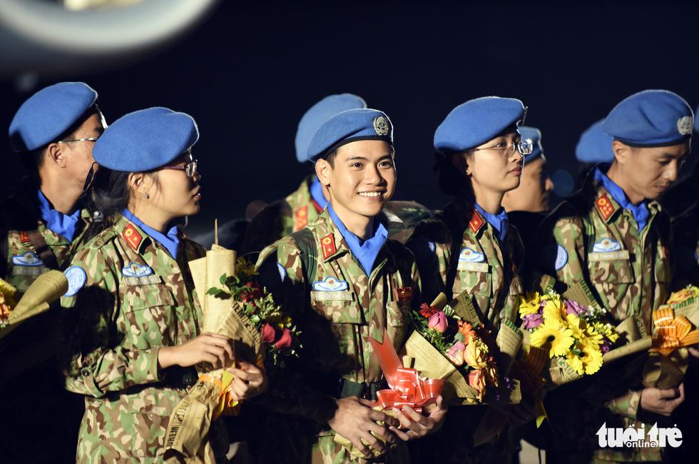 Chiến sĩ mũ nồi xanh về nước sau 1 năm làm nhiệm vụ ở Nam Sudan - Ảnh 2.