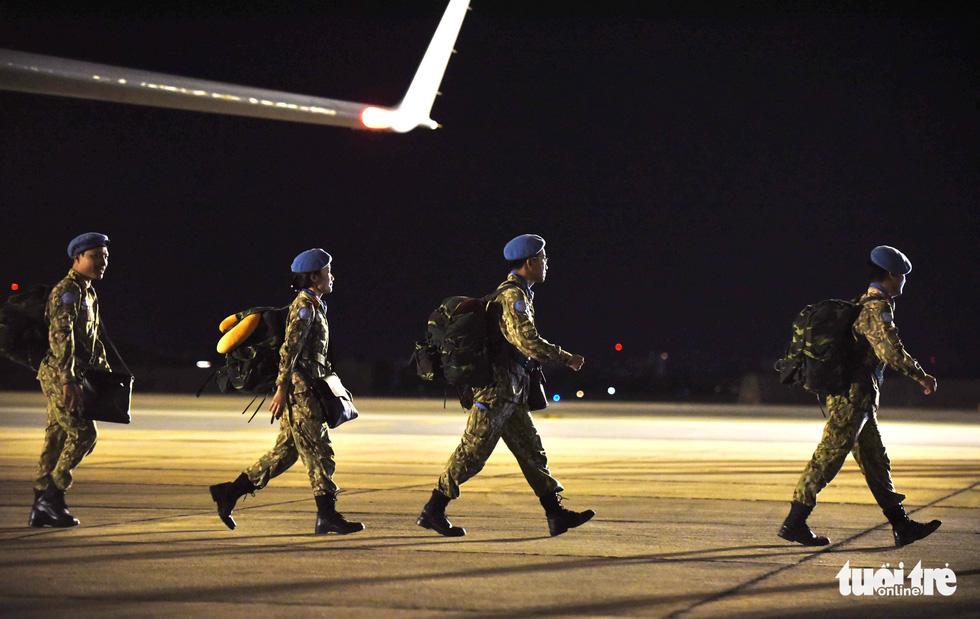 Chiến sĩ mũ nồi xanh về nước sau 1 năm làm nhiệm vụ ở Nam Sudan - Ảnh 6.