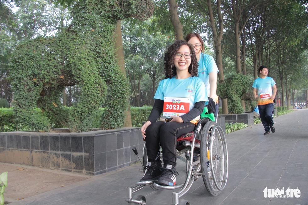 Ghép đôi chạy bộ với người khuyết tật để cùng về đích - Ảnh 7.
