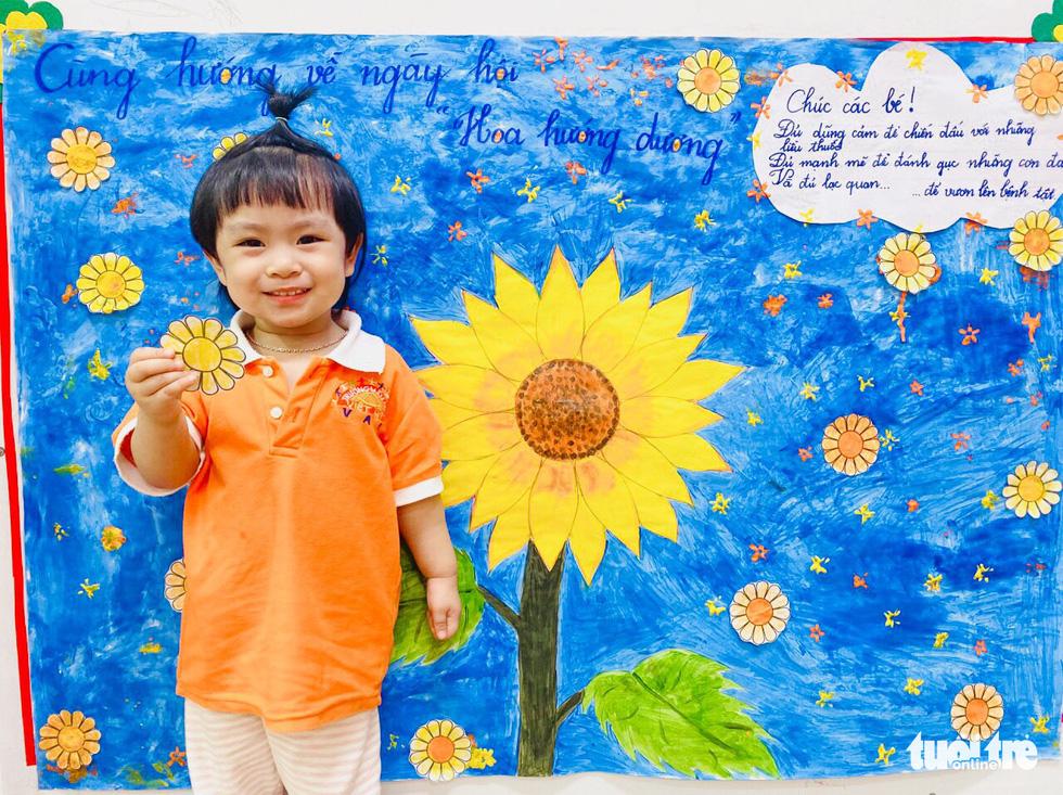 hoc sinh mam non lam hoa huong duong tang benh nhi ung thu