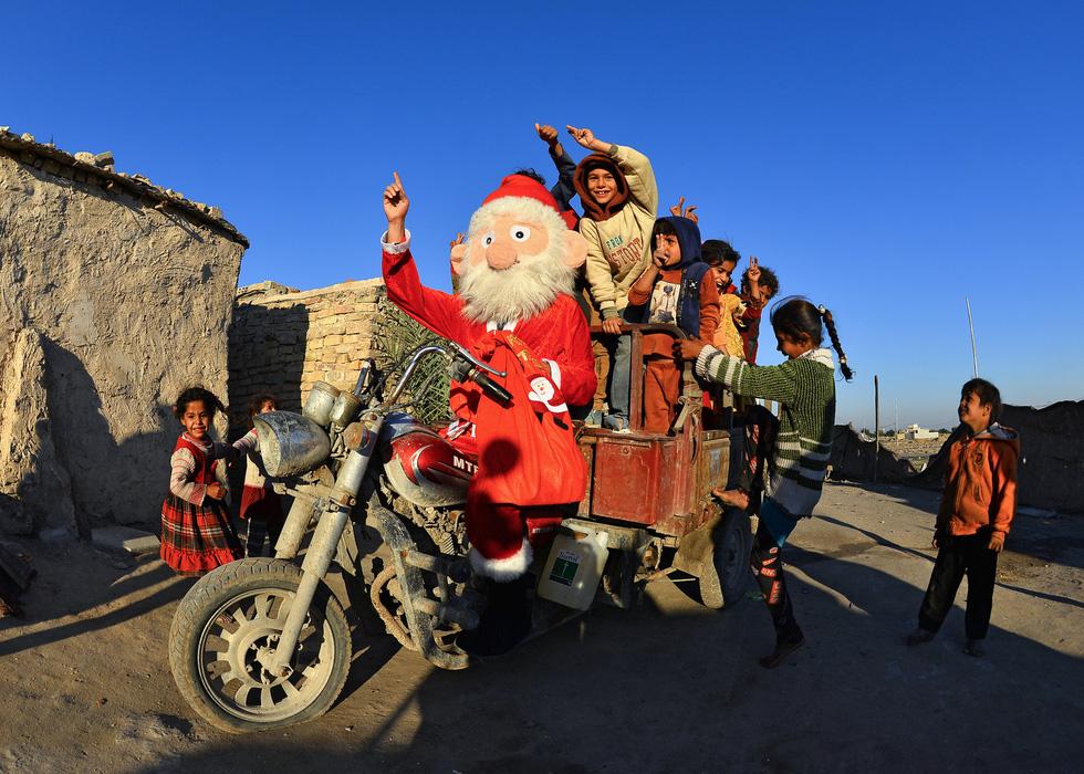 Chùm ảnh: Giáng sinh ấm áp vòng quanh thế giới - Ảnh 6.
