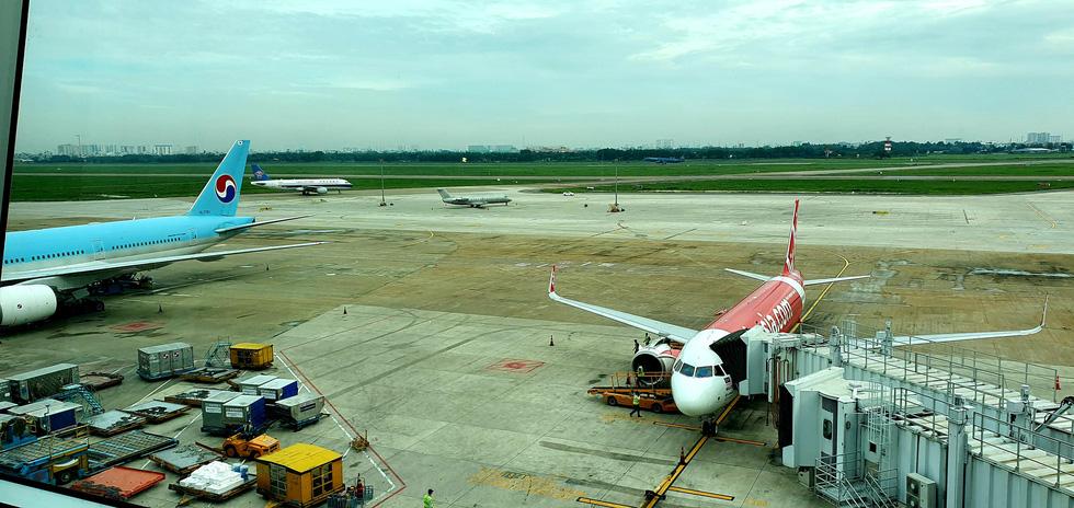 Chuyến bay hạ cánh khẩn cấp ở Tân Sơn Nhất do pin dự phòng nổ, hành khách có lỗi? - Ảnh 1.