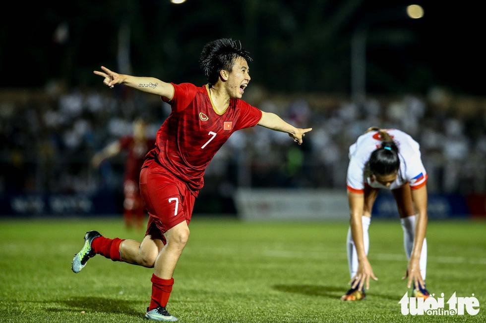 Trận đấu quả cảm của các nữ tuyển thủ Việt Nam - Ảnh 1.