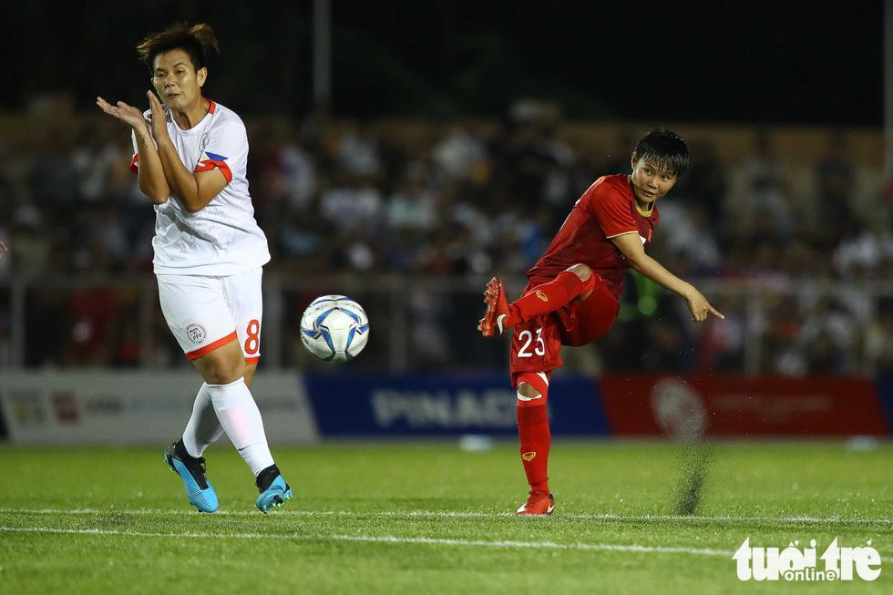 Trận đấu quả cảm của các nữ tuyển thủ Việt Nam - Ảnh 2.
