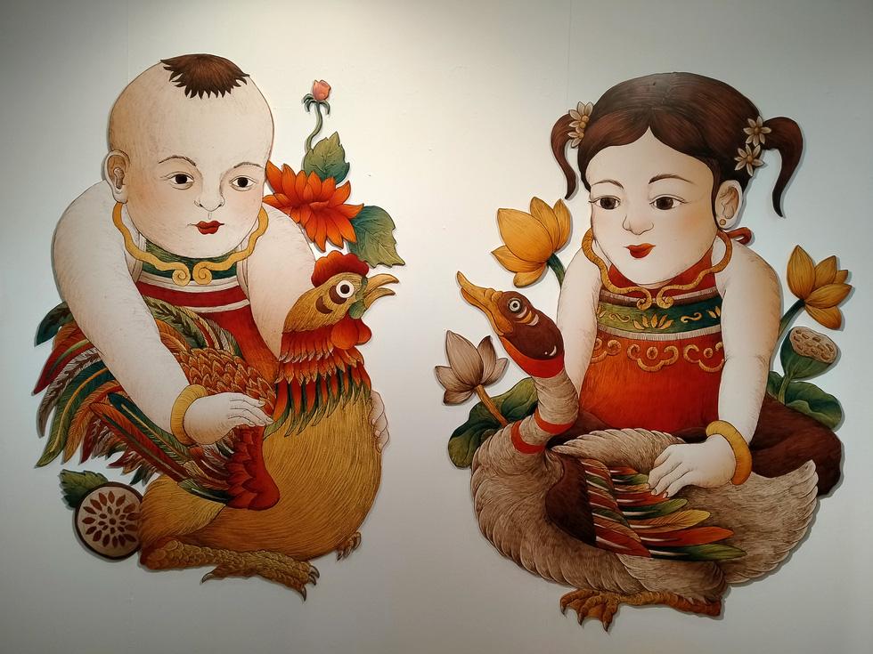 Ngắm Bà Trưng, Bà Triệu, tố nữ mắt to tròn, mặt V-line trong tranh Xuân Lam - Ảnh 11.