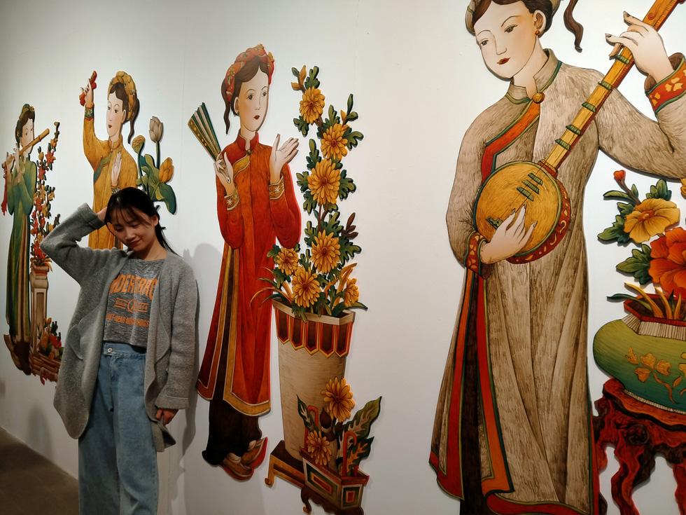 Ngắm Bà Trưng, Bà Triệu, tố nữ mắt to tròn, mặt V-line trong tranh Xuân Lam - Ảnh 4.