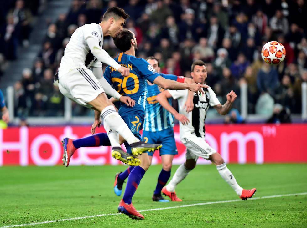 Xem siêu nhân Ronaldo đánh bại Atletico Madrid qua ảnh - Ảnh 1.
