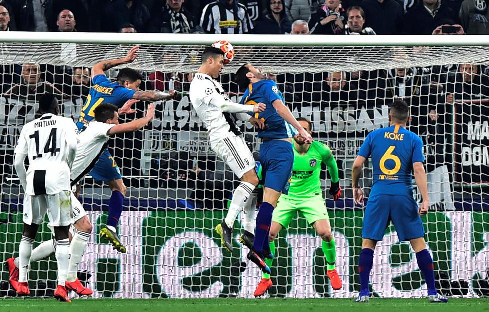 Xem siêu nhân Ronaldo đánh bại Atletico Madrid qua ảnh - Ảnh 4.