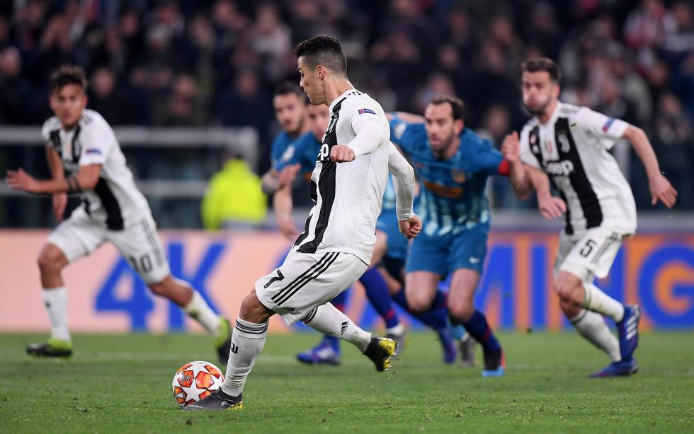 Xem siêu nhân Ronaldo đánh bại Atletico Madrid qua ảnh - Ảnh 8.