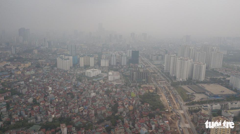 Hà Nội mịt mù trong ô nhiễm nhìn từ flycam - Ảnh 5.