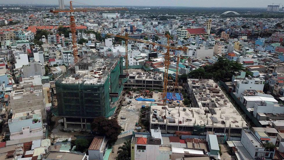 Hơn 100 dự án bất động sản TP.HCM đóng băng, người mua nhà hoang mang - Ảnh 5.