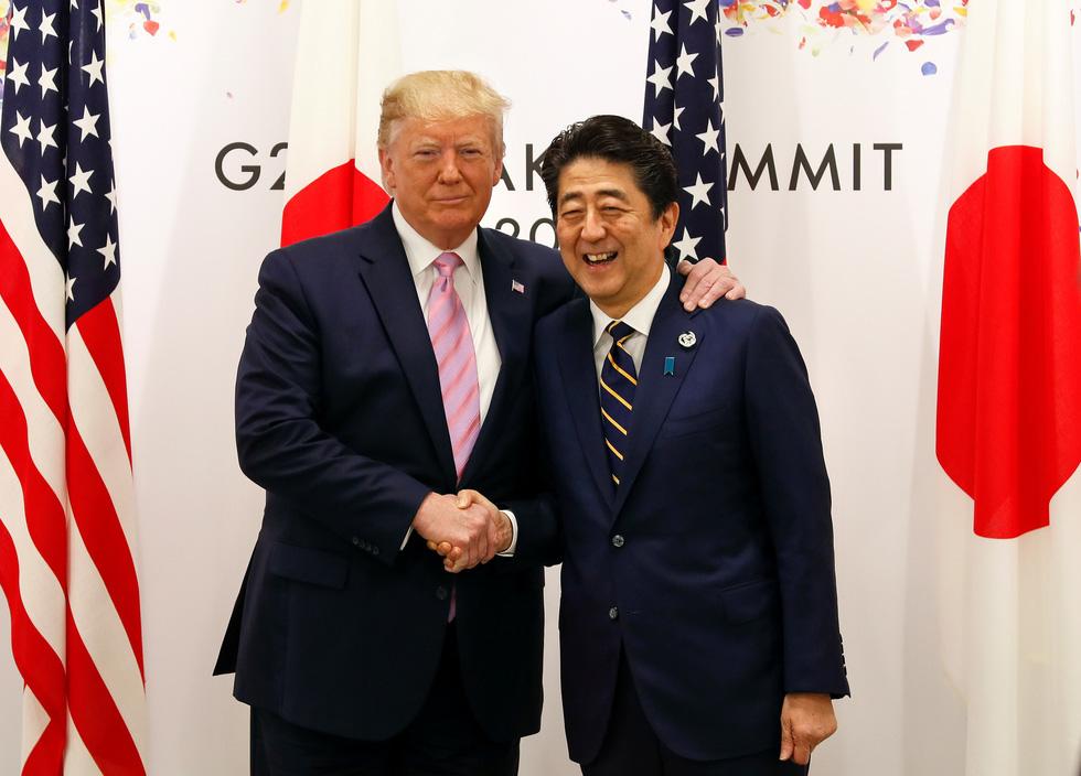 Tiết lộ hậu trường chụp ảnh gia đình G20 ở Osaka - Ảnh 11.