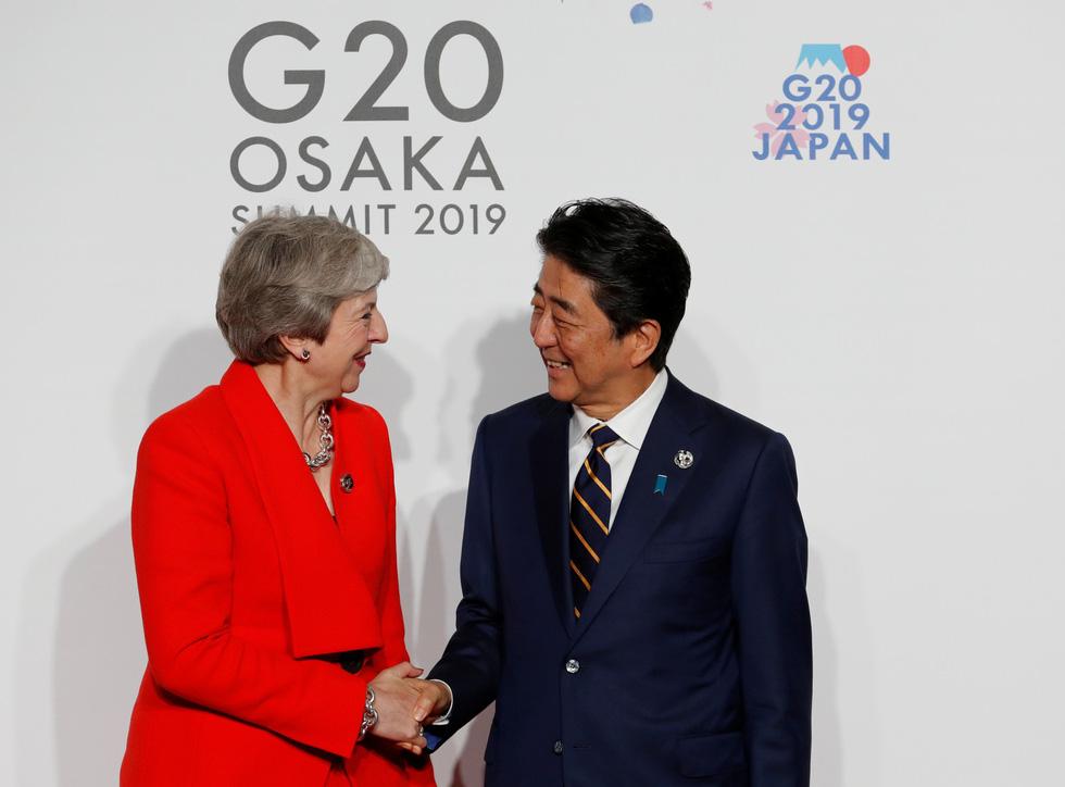 Tiết lộ hậu trường chụp ảnh gia đình G20 ở Osaka - Ảnh 6.
