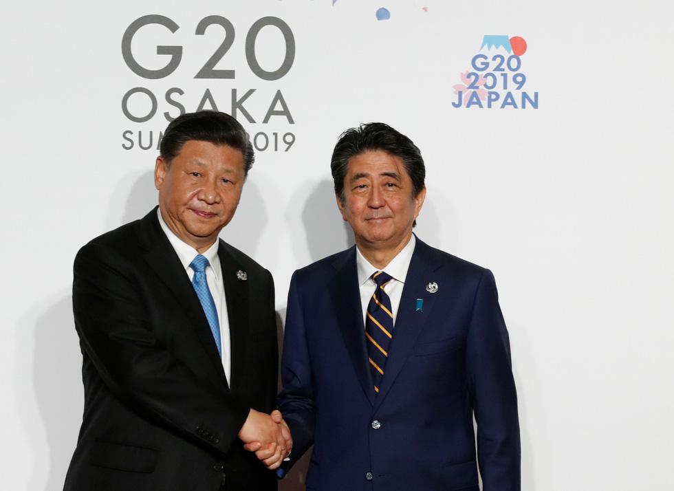 Tiết lộ hậu trường chụp ảnh gia đình G20 ở Osaka - Ảnh 5.
