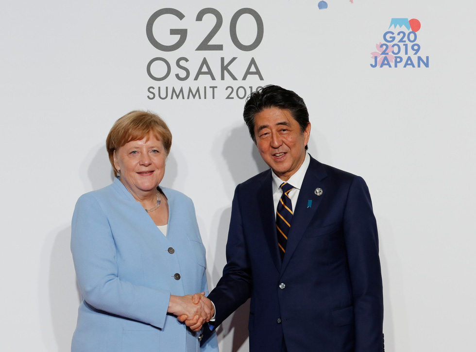 Tiết lộ hậu trường chụp ảnh gia đình G20 ở Osaka - Ảnh 10.