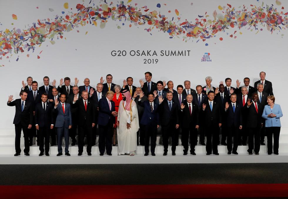 Tiết lộ hậu trường chụp ảnh gia đình G20 ở Osaka - Ảnh 1.