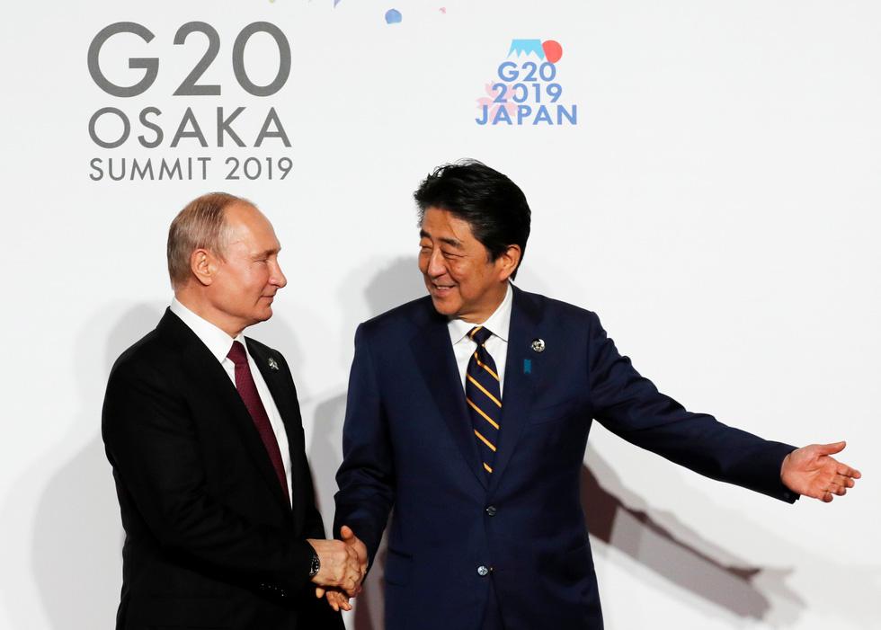 Tiết lộ hậu trường chụp ảnh gia đình G20 ở Osaka - Ảnh 4.