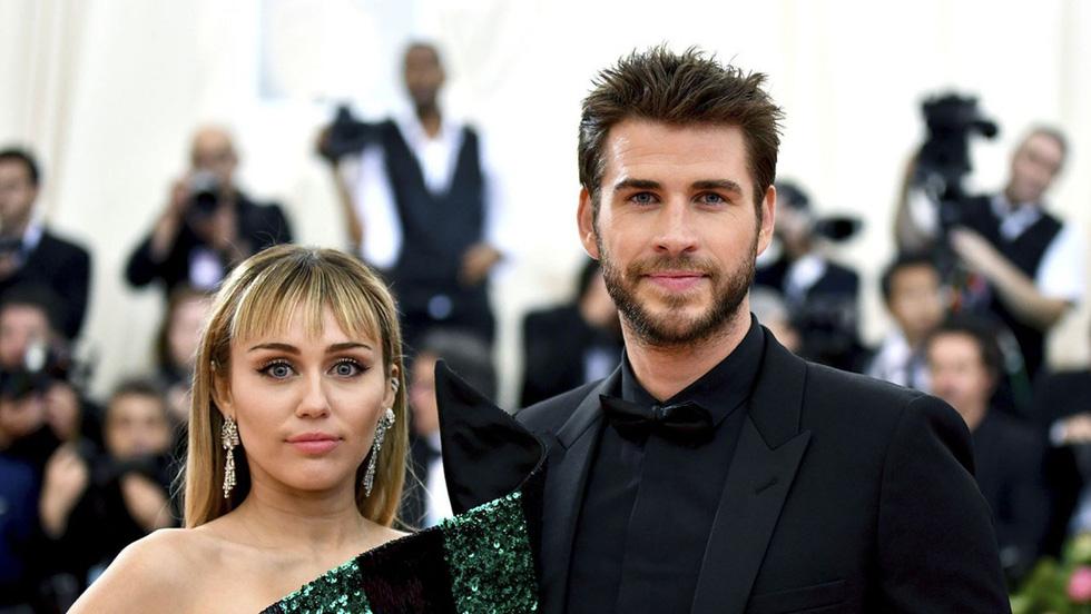 Liam Hemsworth - Miley Cyrus: 10 năm bên nhau, 7 tháng hôn nhân, ly hôn ồn ào - Ảnh 1.