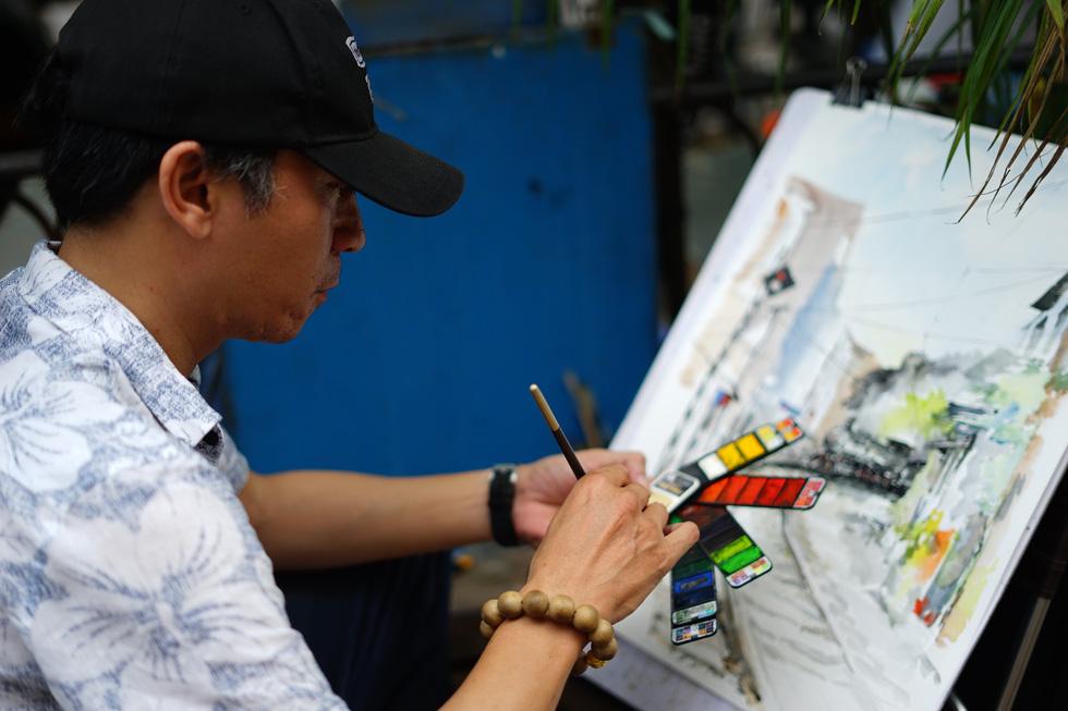 Ký họa đô thị Hà Nội: Những người vẽ bằng tình yêu... - Ảnh 14.