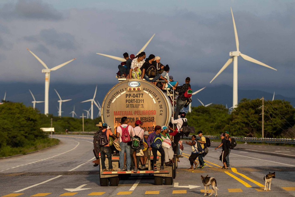 Bộ ảnh 'Đoàn người di cư' thắng giải Ảnh báo chí Quốc tế - Ảnh 6.