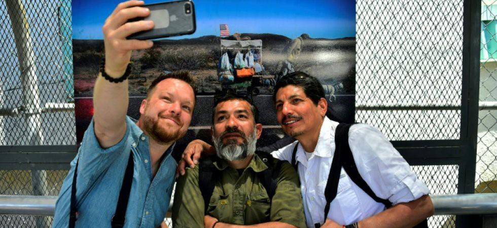 Bộ ảnh 'Đoàn người di cư' thắng giải Ảnh báo chí Quốc tế - Ảnh 2.