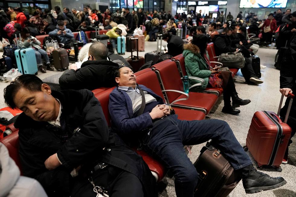Trung Quốc vào cuộc 'Xuân vận' lớn nhất hành tinh với 3 tỉ chuyến về quê ăn Tết - Ảnh 1.