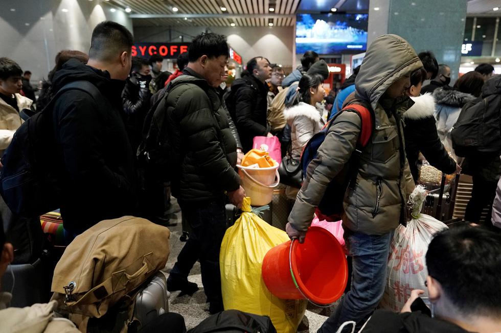 Trung Quốc vào cuộc 'Xuân vận' lớn nhất hành tinh với 3 tỉ chuyến về quê ăn Tết - Ảnh 4.