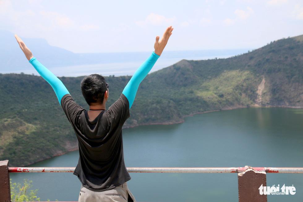 Trước khi 'thức giấc' sau 40 năm, núi lửa ở Philippines hấp dẫn du khách như thế nào? - Ảnh 12.