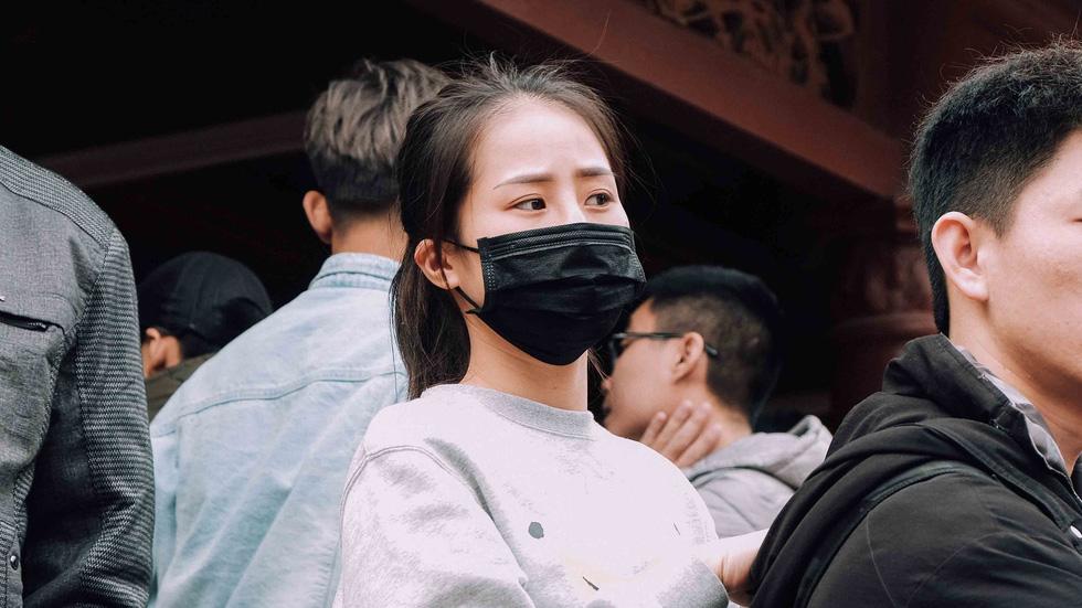 Dân vẫn kéo về khai hội chùa Hương bất chấp virus corona - Ảnh 9.