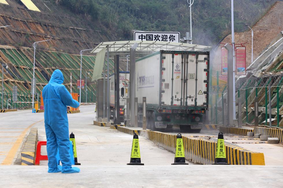 Ngày đầu tiên cửa khẩu Tân Thanh mở lại, 300 tấn nông sản qua Trung Quốc - Ảnh 7.