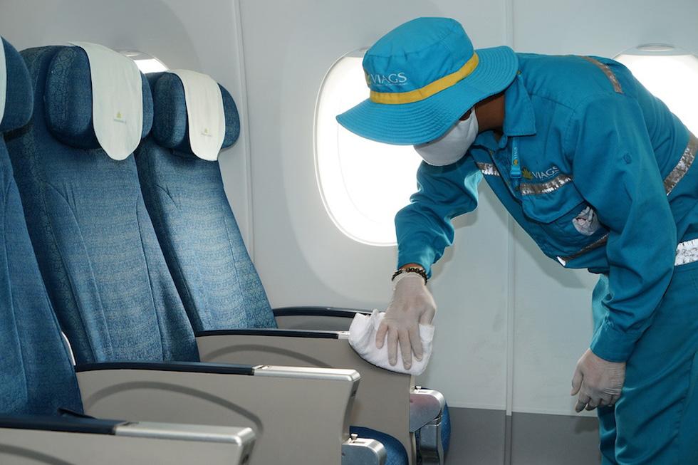 Vietnam Airlines vệ sinh, khử trùng các chuyến bay trong nước thế nào? - Ảnh 4.
