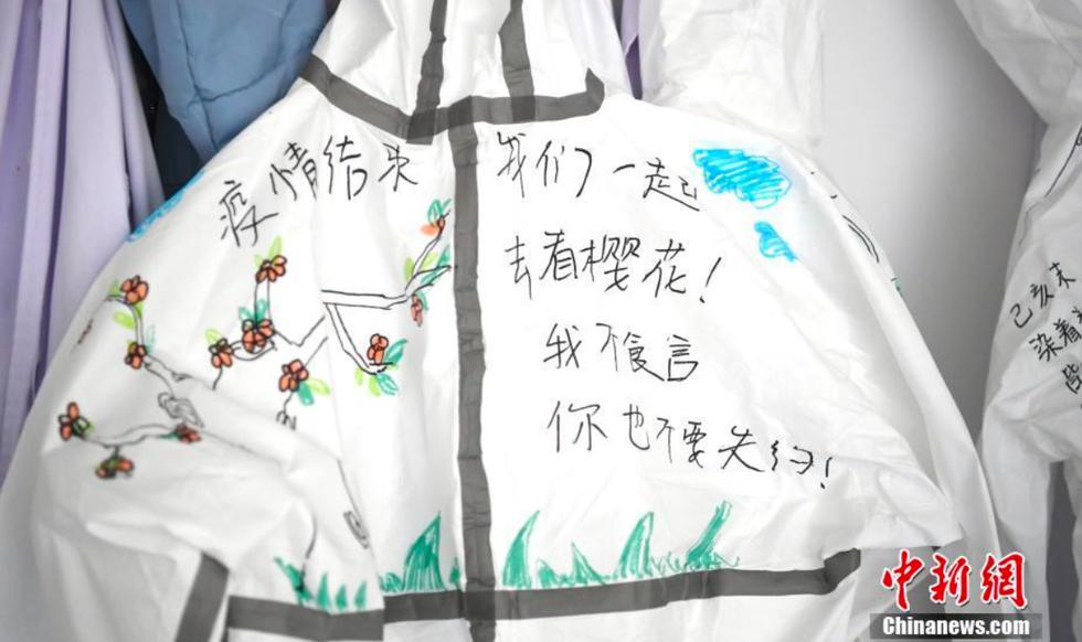 Bộ ảnh Vũ Hán và lời hẹn ước ngắm hoa anh đào - Ảnh 12.