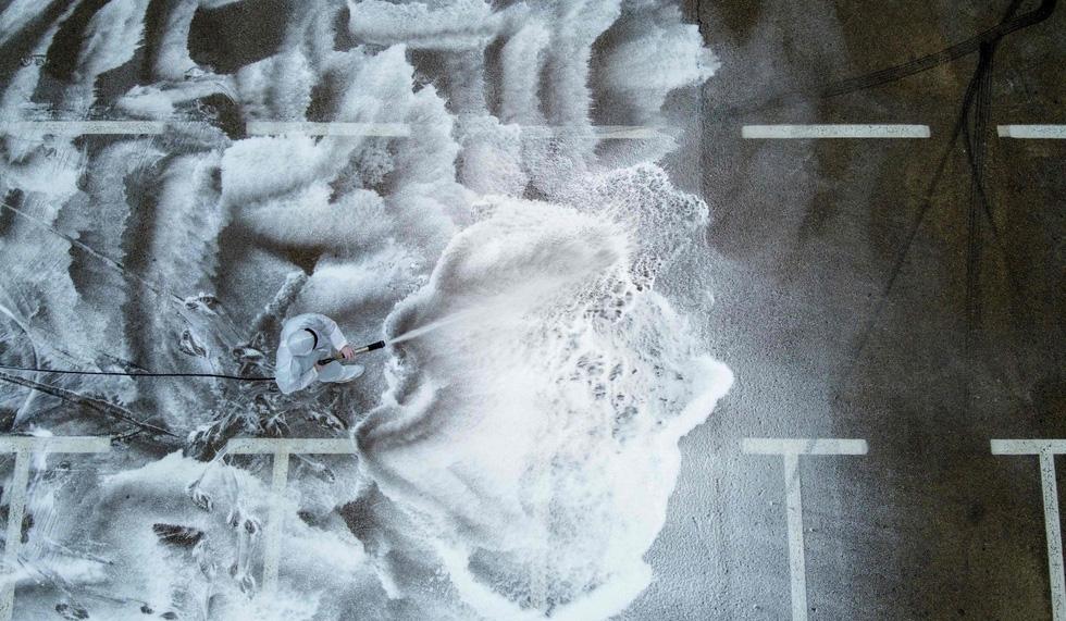 Những hình ảnh ám ảnh nhất tuần qua giữa đại dịch - Ảnh 5.
