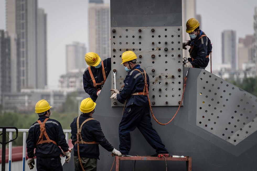 Trung Quốc dỡ phong tỏa Hồ Bắc, 50 triệu dân được tự do đi lại - Ảnh 6.