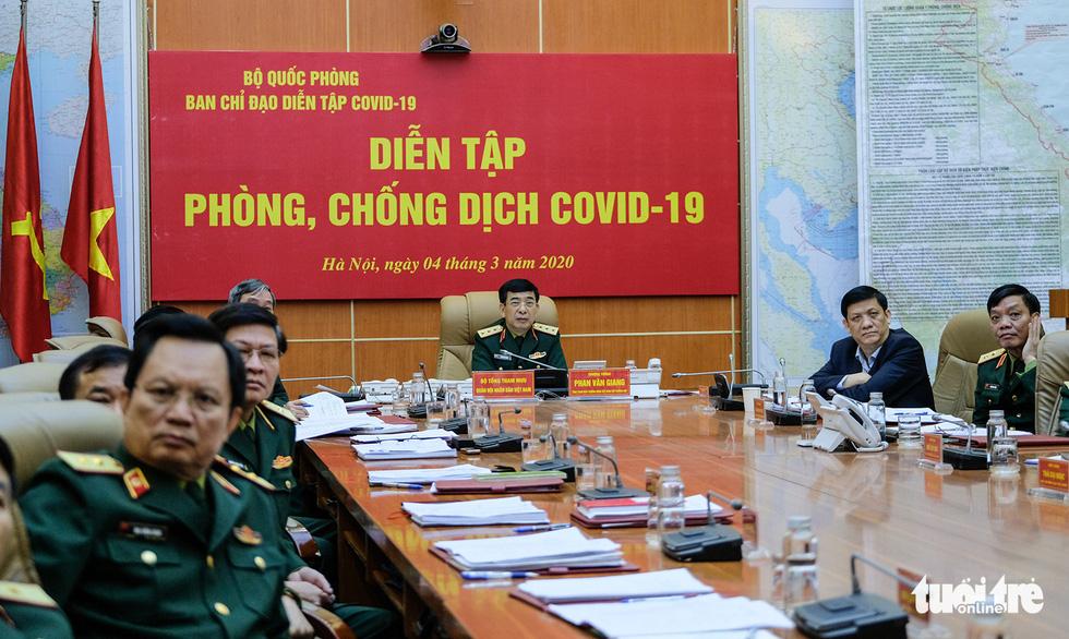 Bộ Quốc phòng diễn tập phòng chống dịch COVID-19 với quy mô chưa từng có - Ảnh 3.