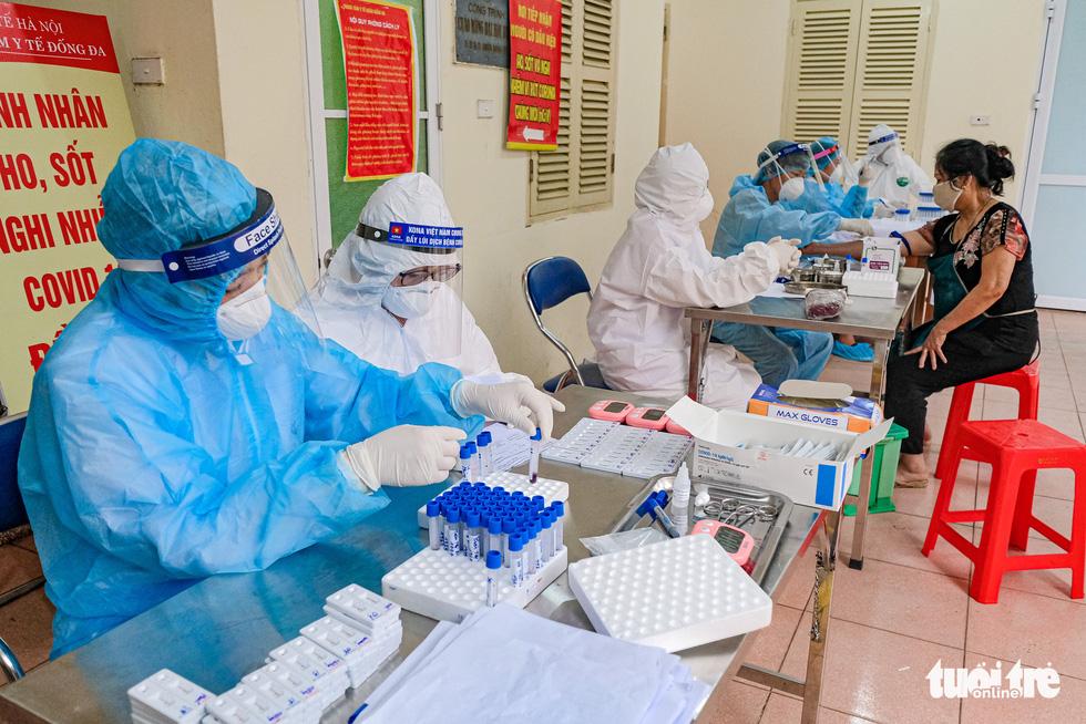 Tiểu thương sẵn sàng nghỉ làm để được xét nghiệm nhanh COVID-19 - Ảnh 5.