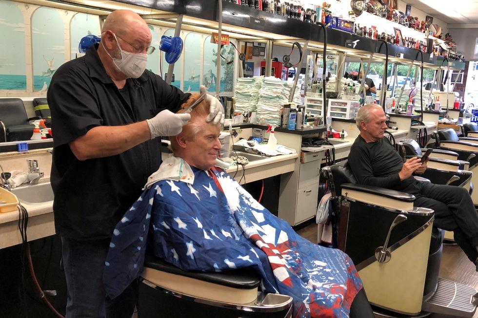 Vừa nới lỏng phong tỏa, cả thế giới tranh thủ cắt tóc, làm đẹp… - Ảnh 1.