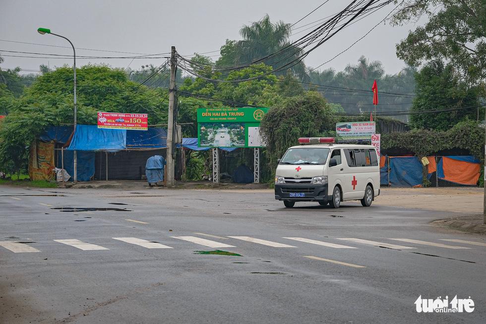 Cận cảnh cách ly thôn Hạ Lôi hơn 10.000 nhân khẩu vì liên quan bệnh nhân 243 - Ảnh 13.