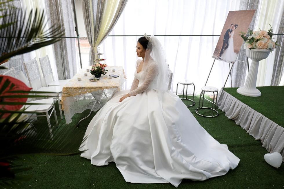 Đám cưới Việt Nam thời COVID-19 trên Hãng tin Reuters - Ảnh 5.