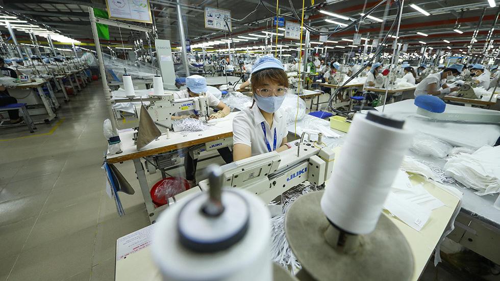 Khẩu trang Việt giúp thế giới an toàn hơn - Ảnh 4.