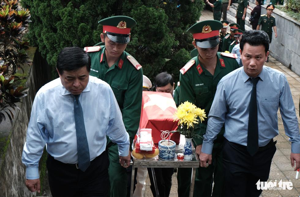 Đưa liệt sĩ từ núi đá, hang sâu về an nghỉ tại nghĩa trang Vị Xuyên - Ảnh 1.