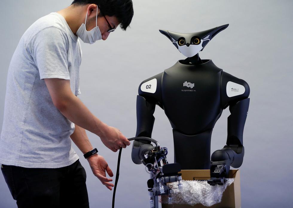 Robot kangaroo làm nhân viên của FamilyMart ở Nhật - Ảnh 4.